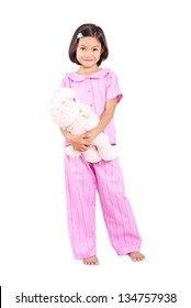 Girl in pajama hugging a teddy bear.Full body shot. Isolated in white background.