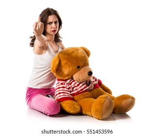 Girl with pajamas making horn gesture