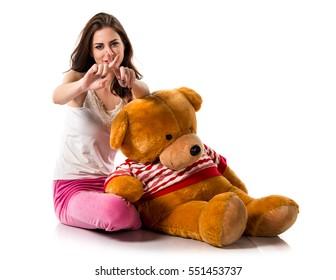 Girl with pajamas making NO gesture