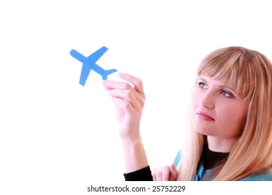 Girl with paper airplane in the hand