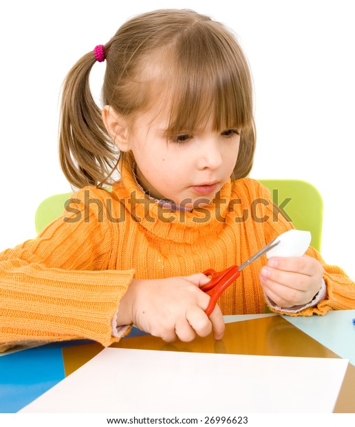 girl with paper and scissors isolated on white