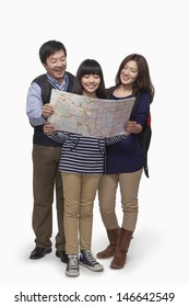 Girl with parents checking map