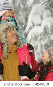 Girl and parents in snow
