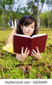 Girl in park with book