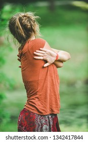 Girl in the park. Doing yoga in a natural setting.