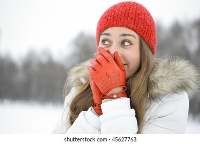 Girl in the Park laughs, closes his hand in mittened red