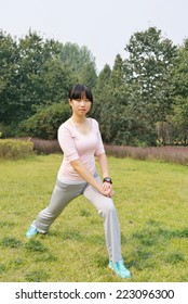 A girl in the park lawn fitness
