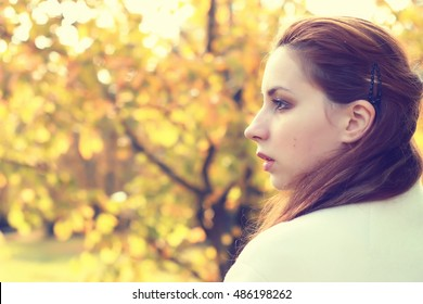 girl in a park walk autumn alone