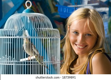 Girl with Parrot in a cage