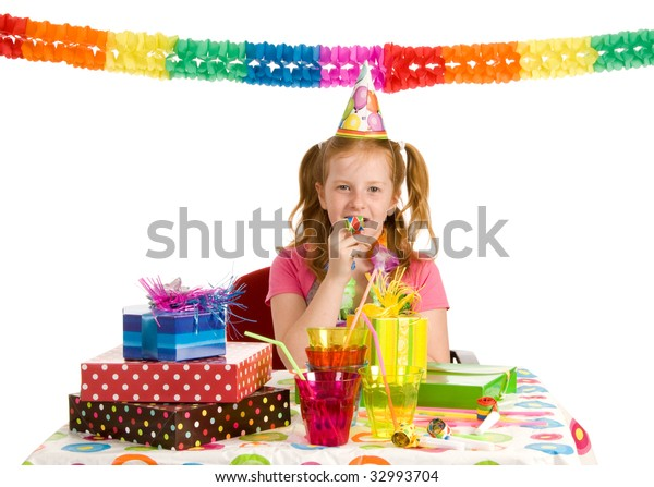 A girl with a party blower on her birthday party