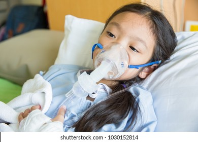 Girl patient treating and healing with respiratory mask equipment in hospital