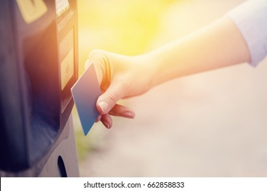 girl pays the ticket to the parking place of the car and the payment of the fare on the way. Concept of new technologies in road transport and toll roads.