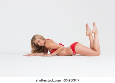 a289913d50 Girl with perfect body in red underwear on white background