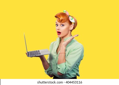 Girl with personal computer. Closeup red head beautiful young woman pretty excited, amazed smiling pinup girl green button shirt holding pc hand up looking at you camera, retro vintage 50's hairstyle