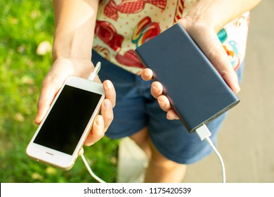 girl with phone and power bank