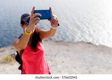 Girl photographed herselvf near sea
