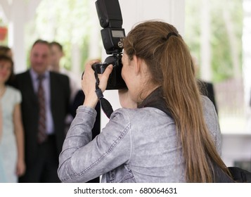 The girl photographer photographing a wedding