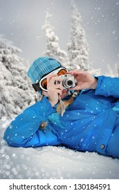 girl photographer snow mountain background