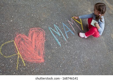 """Girl with pigtails wrote in chalk on the pavement, """"I love mom"""""""