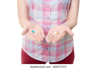 girl with pills in hand