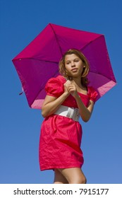Girl in pink with bright pink umbrella