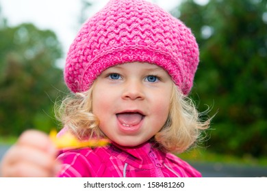 Girl with pink cap