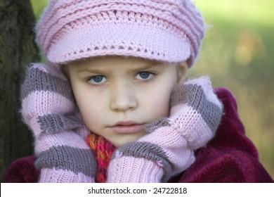 A girl in a pink cap