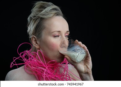 a girl in a pink collar drinking milk