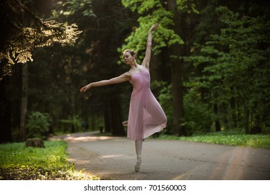 Girl in pink costume dancing in the park