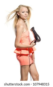 girl in pink dress with hairdryer