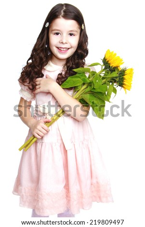 f36578fad1 girl in a pink dress holding a bouquet of sunflowers on a white background