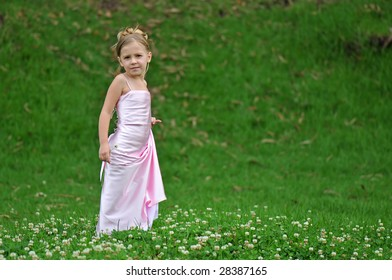 Girl in pink dress on the grass