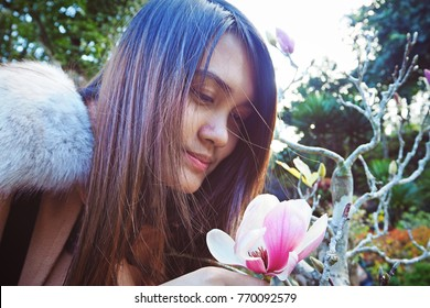 Girl with pink flowers in winter