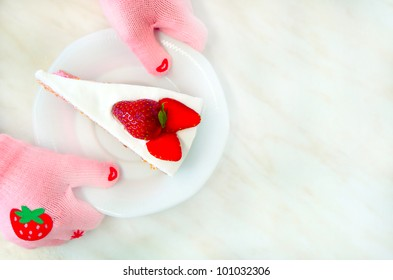 Girl in pink glove holding strawberry cake