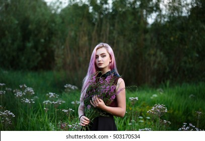 girl with pink hair in a field with a bouquet