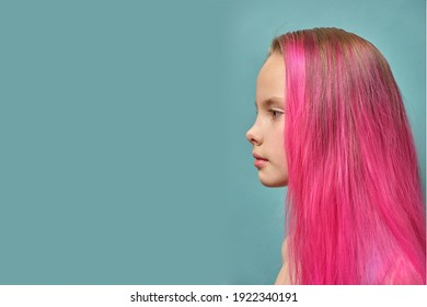 a girl with pink hair. Model with the colored chips. A woman with a voluminous hairstyle and beautiful large lips, a side view in profile of a beautiful girl of model appearance. mock up