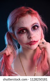 Girl with Pink Hair and Red Eyes Wearing Cosplay Makeup