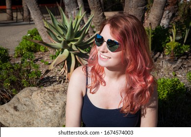 Girl with pink hair and sunglasses