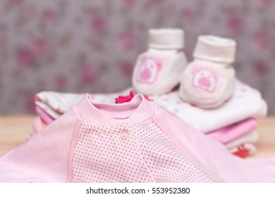 Its a Girl pink theme Baby Shower or Nursery background with decorated borders on wood background