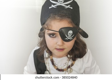 Girl in a pirate costume, ready for a birthday party.
