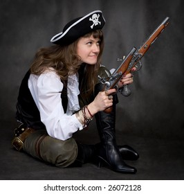 Girl - pirate on black with two pistols in hands