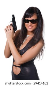 The girl with a pistol on a white background