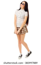 Girl in plaid skirt with sunglasses isolated