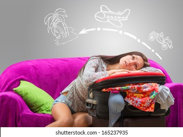 Girl planning her journey to the tropical island by car and by airplane
