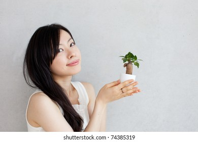 Girl with a plant
