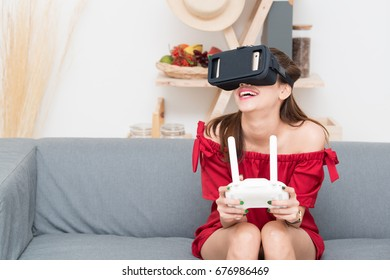 Girl play drone with VR.