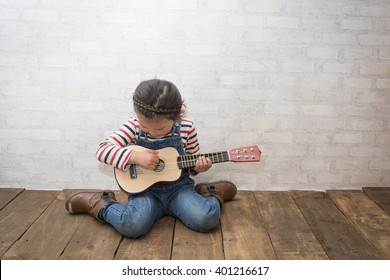 Girl to play the guitar