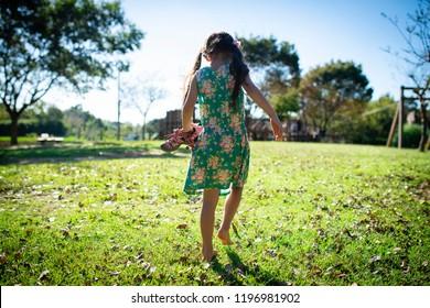Girl playing barefoot