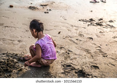 The girl is playing at the beach