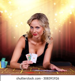 Girl playing in casino.girl holding the winning combination of poker cards